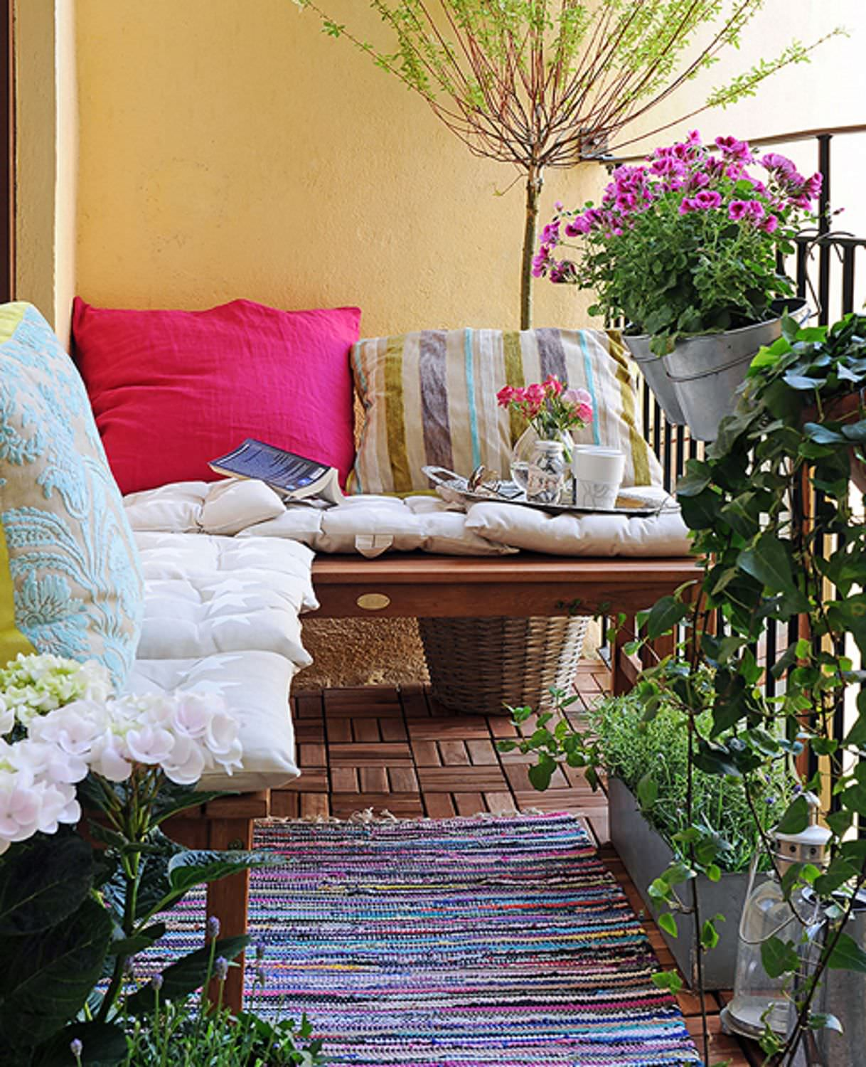 A colored carpet will refresh your terrace balcony beautiful.